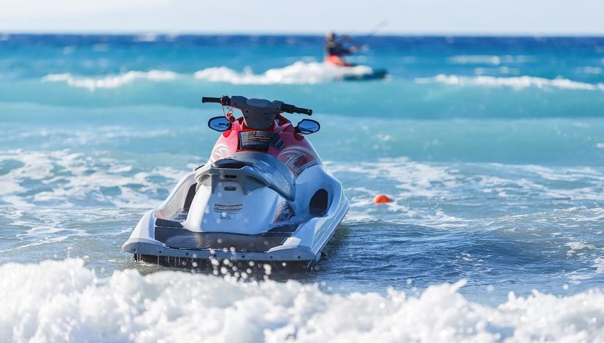 "alt=""jet ski travel scam"